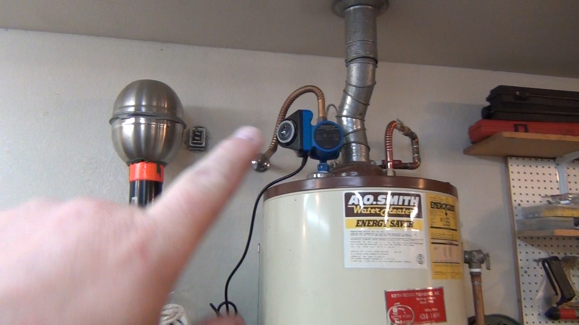 My install of the pump on top of the water heater. Really easy to install